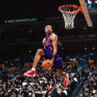 Vince Carter shoots during the All Star Weekend slam dunk contest.